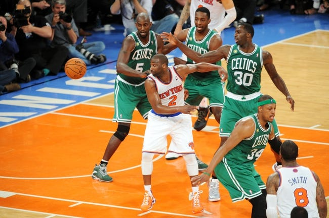 May 1, 2013; New York, NY, USA; New York Knicks point guard Raymond Felton (2) goes after a loose ball against the Boston Celtics during the second half in game five of the first round of the 2013 NBA Playoffs at Madison Square Garden. The Celtics won the game 92-86. Mandatory Credit: Joe Camporeale-USA TODAY Sports