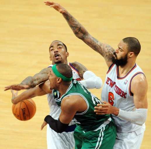 May 1, 2013; New York, NY, USA; New York Knicks center Tyson Chandler (6) and shooting guard J.R. Smith (8) defend against Boston Celtics small forward Paul Pierce (34) during the second half in game five of the first round of the 2013 NBA Playoffs at Madison Square Garden. The Celtics won the game 92-86. Mandatory Credit: Joe Camporeale-USA TODAY Sports