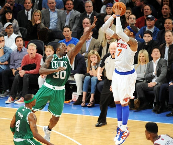 May 1, 2013; New York, NY, USA; New York Knicks small forward Carmelo Anthony (7) takes a shot over Boston Celtics power forward Brandon Bass (30) during the second half in game five of the first round of the 2013 NBA Playoffs at Madison Square Garden. The Celtics won the game 92-86. Mandatory Credit: Joe Camporeale-USA TODAY Sports