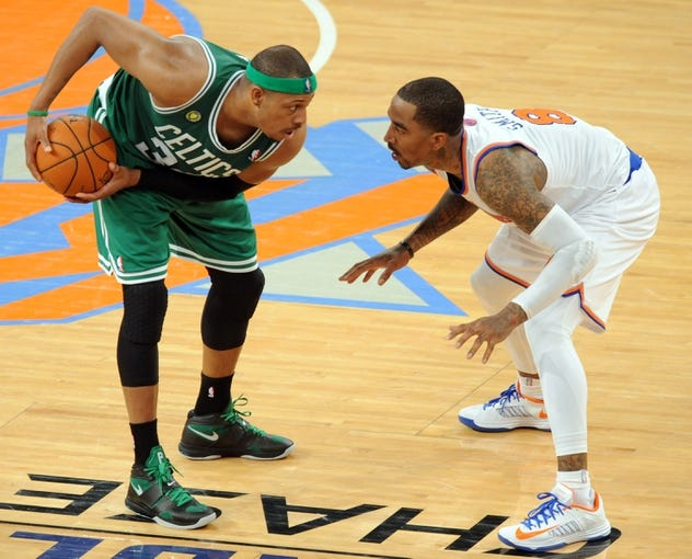 May 1, 2013; New York, NY, USA; New York Knicks shooting guard J.R. Smith (8) defends against Boston Celtics small forward Paul Pierce (34) during the second half in game five of the first round of the 2013 NBA Playoffs at Madison Square Garden. The Celtics won the game 92-86. Mandatory Credit: Joe Camporeale-USA TODAY Sports