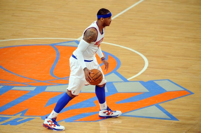 May 1, 2013; New York, NY, USA; New York Knicks small forward Carmelo Anthony (7) dribbles against the Boston Celtics during the first half in game five of the first round of the 2013 NBA Playoffs at Madison Square Garden. Mandatory Credit: Joe Camporeale-USA TODAY Sports