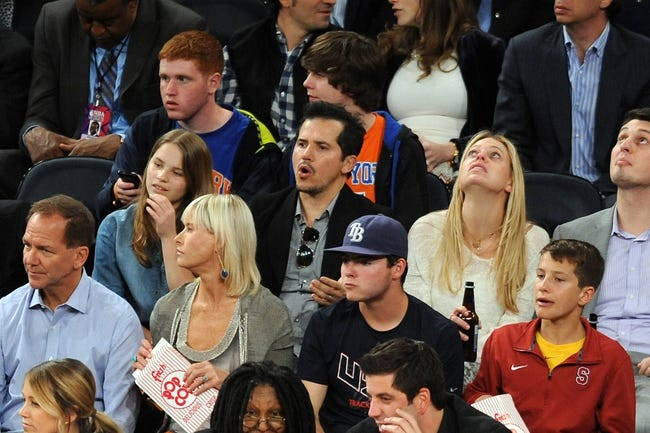 May 1, 2013; New York, NY, USA; Film actor John Leguizamo (center) looks on at the New York Knicks and Boston Celtics game during the first half in game five of the first round of the 2013 NBA Playoffs at Madison Square Garden. Mandatory Credit: Joe Camporeale-USA TODAY Sports