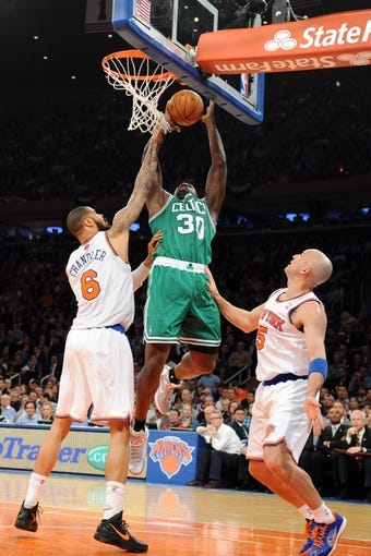 May 1, 2013; New York, NY, USA; Boston Celtics power forward Brandon Bass (30) puts up a shot over New York Knicks center Tyson Chandler (6) during the first half in game five of the first round of the 2013 NBA Playoffs at Madison Square Garden. Mandatory Credit: Joe Camporeale-USA TODAY Sports