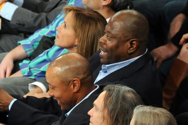 May 1, 2013; New York, NY, USA; News anchor Katie Couric (top) and New York Knicks great Patrick Ewing (center) look on at the against the Boston Celtics and New York Knicks game during the first half in game five of the first round of the 2013 NBA Playoffs at Madison Square Garden. Mandatory Credit: Joe Camporeale-USA TODAY Sports