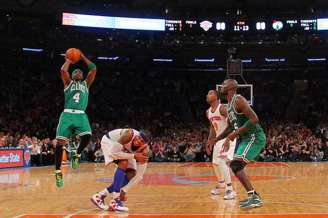 May 1, 2013; New York, NY, USA; Boston Celtics guard Jason Terry (4) shoots over an injured New York Knicks forward Carmelo Anthony (7) in front of guard J.R. Smith (8) and Celtics center Kevin Garnett (5) during the fourth quarter of game five of the first round of the 2013 NBA Playoffs at Madison Square Garden. Mandatory Credit: Brad Penner-USA TODAY Sports