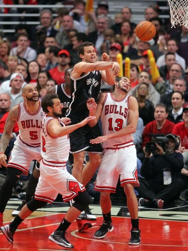 May 2, 2013; Chicago, IL, USA; Brooklyn Nets power forward Kris Humphries (43) passes over Chicago Bulls center Joakim Noah (13) during the second half in game six of the first round of the 2013 NBA Playoffs at the United Center. Brooklyn won 95-92. Mandatory Credit: Dennis Wierzbicki-USA TODAY Sports