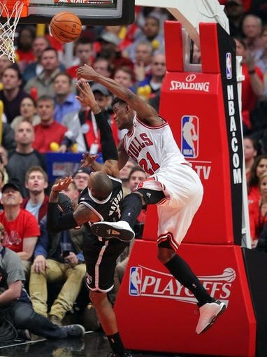 May 2, 2013; Chicago, IL, USA; Brooklyn Nets point guard C.J. Watson (1) is fouled by Chicago Bulls small forward Jimmy Butler (21) during the second half in game six of the first round of the 2013 NBA Playoffs at the United Center. Brooklyn won 95-92. Mandatory Credit: Dennis Wierzbicki-USA TODAY Sports