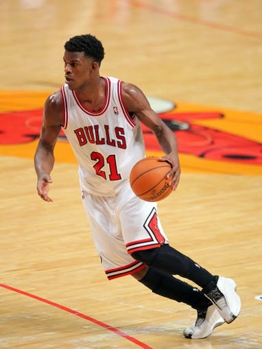 May 2, 2013; Chicago, IL, USA; Chicago Bulls small forward Jimmy Butler (21) with the ball during the second half against the Brooklyn Nets in game six of the first round of the 2013 NBA Playoffs at the United Center. Brooklyn won 95-92. Mandatory Credit: Dennis Wierzbicki-USA TODAY Sports