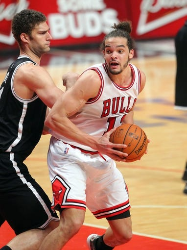 May 2, 2013; Chicago, IL, USA; Chicago Bulls center Joakim Noah (13) is defended by Brooklyn Nets center Brook Lopez (11) during the second half in game six of the first round of the 2013 NBA Playoffs at the United Center. Brooklyn won 95-92. Mandatory Credit: Dennis Wierzbicki-USA TODAY Sports