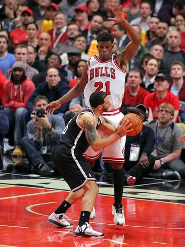 May 2, 2013; Chicago, IL, USA; Brooklyn Nets point guard Deron Williams (8) is defended by Chicago Bulls small forward Jimmy Butler (21) during the second half in game six of the first round of the 2013 NBA Playoffs at the United Center. Brooklyn won 95-92. Mandatory Credit: Dennis Wierzbicki-USA TODAY Sports