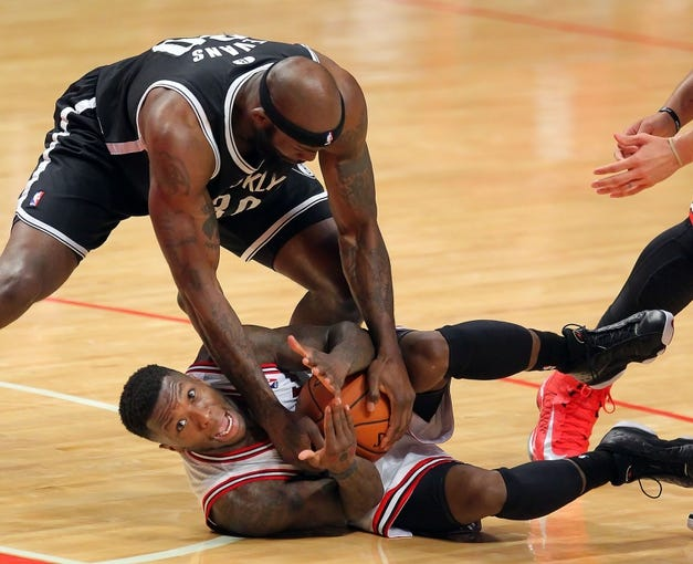 May 2, 2013; Chicago, IL, USA; Chicago Bulls point guard Nate Robinson (2) and Brooklyn Nets power forward Reggie Evans (30) battle for the ball during the second half in game six of the first round of the 2013 NBA Playoffs at the United Center. Brooklyn won 95-92. Mandatory Credit: Dennis Wierzbicki-USA TODAY Sports