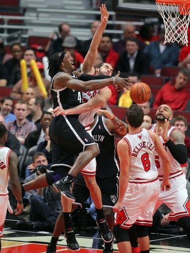 May 2, 2013; Chicago, IL, USA; Brooklyn Nets small forward Gerald Wallace (45) is fouled by Chicago Bulls center Joakim Noah (13) during the second half in game six of the first round of the 2013 NBA Playoffs at the United Center. Brooklyn won 95-92. Mandatory Credit: Dennis Wierzbicki-USA TODAY Sports