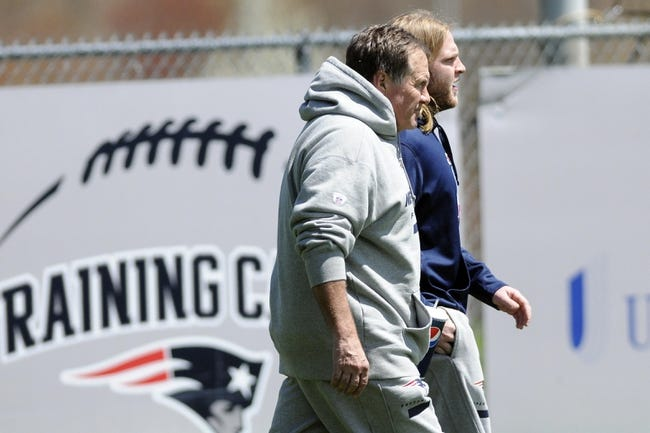 May 3, 2013; Foxboro, MA USA; New England Patriot head coach Bill Belichick and his son Steve Belichick walk onto the practice field during rookie minicamp at Gillette Stadium. Mandatory Credit: Bob DeChiara-USA TODAY Sports