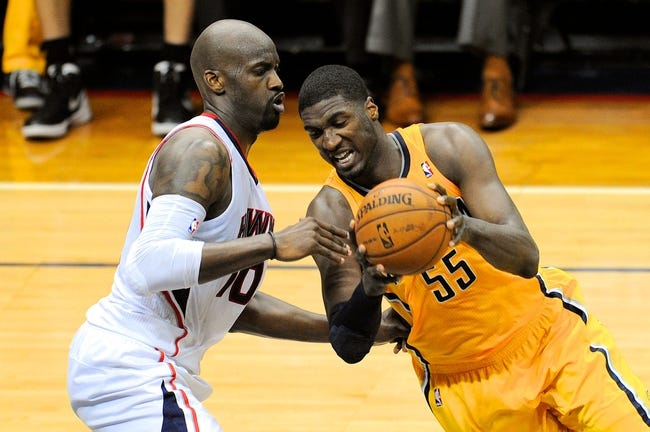 May 3, 2013; Atlanta, GA, USA; Indiana Pacers center Roy Hibbert (55) controls the ball against Atlanta Hawks center Johan Petro (10) during the second half in game six of the first round of the 2013 NBA Playoffs at Philips Arena. The Pacers defeated the Hawks 81-73 to win the series four games to two. Mandatory Credit: Dale Zanine-USA TODAY Sports
