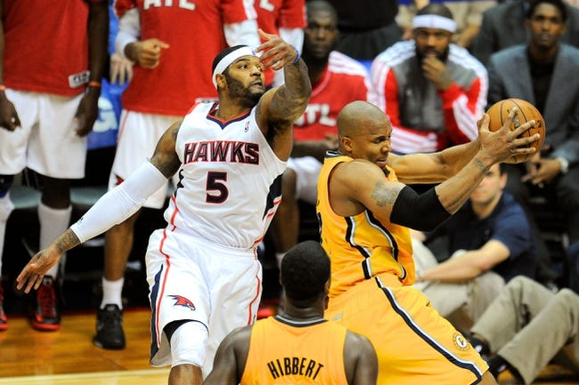 May 3, 2013; Atlanta, GA, USA; Indiana Pacers power forward David West (21) grabs a rebound in front of Atlanta Hawks small forward Josh Smith (5) during the second half in game six of the first round of the 2013 NBA Playoffs at Philips Arena. The Pacers defeated the Hawks 81-73 to win the series four games to two. Mandatory Credit: Dale Zanine-USA TODAY Sports