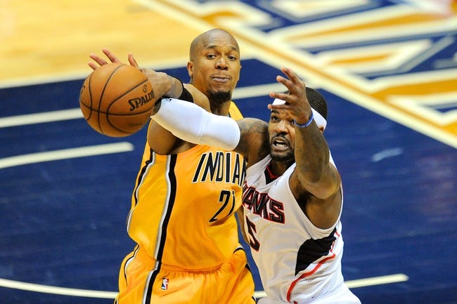 May 3, 2013; Atlanta, GA, USA; Indiana Pacers power forward David West (21) fights for the ball with Atlanta Hawks small forward Josh Smith (5) during the second half in game six of the first round of the 2013 NBA Playoffs at Philips Arena. The Pacers defeated the Hawks 81-73 to win the series four games to two. Mandatory Credit: Dale Zanine-USA TODAY Sports
