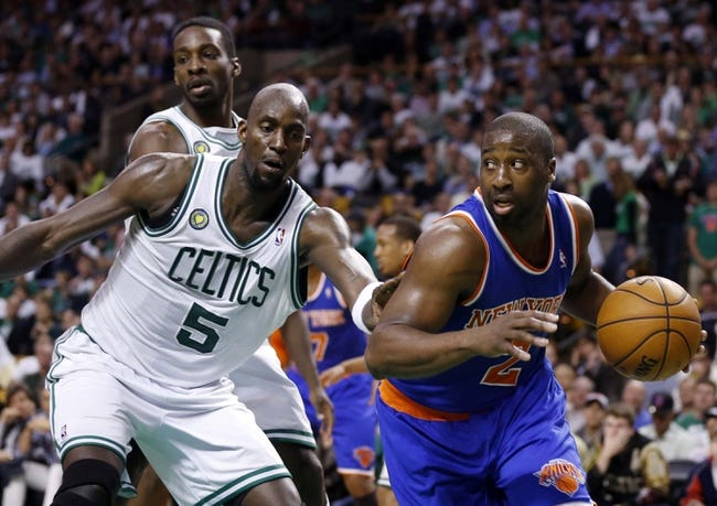 May 3, 2013; Boston, MA, USA; New York Knicks point guard Raymond Felton (2) drives the ball against Boston Celtics center Kevin Garnett (5) in game six of the first round of the 2013 NBA Playoffs at TD Garden. The New York Knicks defeated the Celtics 88-80. Mandatory Credit: David Butler II-USA TODAY Sports