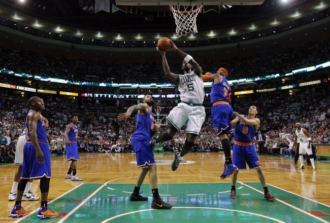 May 3, 2013; Boston, MA, USA; Boston Celtics center Kevin Garnett (5) shoots against New York Knicks small forward Carmelo Anthony (7) in game six of the first round of the 2013 NBA Playoffs at TD Garden. The New York Knicks defeated the Celtics 88-80. Mandatory Credit: David Butler II-USA TODAY Sports