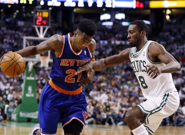 May 3, 2013; Boston, MA, USA; New York Knicks small forward Iman Shumpert (21) drives the ball against Boston Celtics power forward Jeff Green (8) in game six of the first round of the 2013 NBA Playoffs at TD Garden. The New York Knicks defeated the Celtics 88-80. Mandatory Credit: David Butler II-USA TODAY Sports
