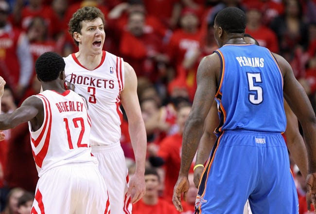 May 3, 2013; Houston, TX, USA; Houston Rockets center Omer Asik (3) and Oklahoma City Thunder center Kendrick Perkins (5) exchange words during the first quarter in game six of the first round of the 2013 NBA Playoffs at the Toyota Center. Mandatory Credit: Troy Taormina-USA TODAY Sports