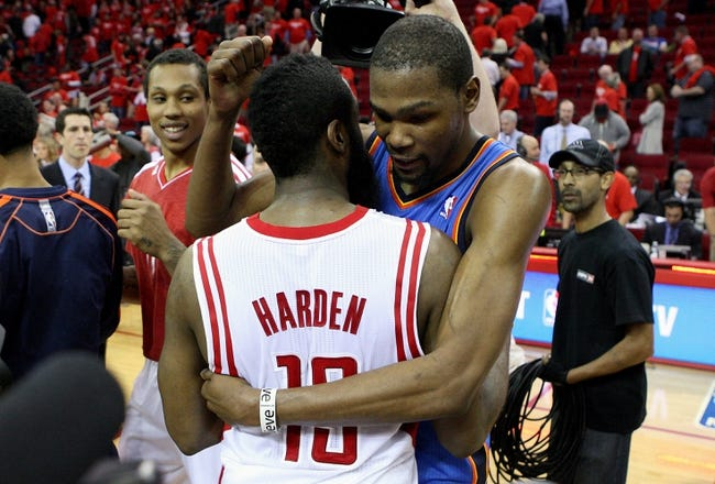 May 3, 2013; Houston, TX, USA; Oklahoma City Thunder small forward Kevin Durant (35) hugs Houston Rockets shooting guard James Harden (13) after game six of the first round of the 2013 NBA Playoffs at the Toyota Center. The Thunder defeated the Rockets 103-94. Mandatory Credit: Troy Taormina-USA TODAY Sports
