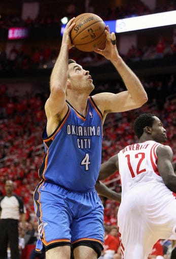 May 3, 2013; Houston, TX, USA; Oklahoma City Thunder power forward Nick Collison (4) attempts to score a basket during the fourth quarter in game six of the first round of the 2013 NBA Playoffs against the Houston Rockets at the Toyota Center. Mandatory Credit: Troy Taormina-USA TODAY Sports