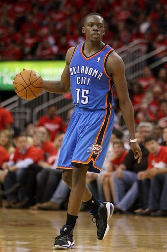 May 3, 2013; Houston, TX, USA; Oklahoma City Thunder point guard Reggie Jackson (15) controls the ball during the fourth quarter against the Houston Rockets in game six of the first round of the 2013 NBA Playoffs at the Toyota Center. Mandatory Credit: Troy Taormina-USA TODAY Sports