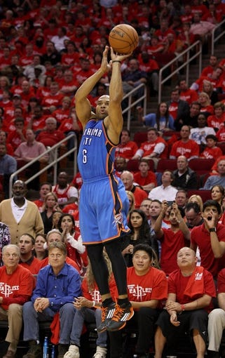 May 3, 2013; Houston, TX, USA; Oklahoma City Thunder point guard Derek Fisher (6) attempts a jump shot during the fourth quarter against the Houston Rockets in game six of the first round of the 2013 NBA Playoffs at the Toyota Center. Mandatory Credit: Troy Taormina-USA TODAY Sports