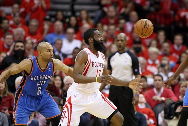 May 3, 2013; Houston, TX, USA; Houston Rockets shooting guard James Harden (13) loses control of the ball during the fourth quarter as Oklahoma City Thunder point guard Derek Fisher (6) defends in game six of the first round of the 2013 NBA Playoffs at the Toyota Center. Mandatory Credit: Troy Taormina-USA TODAY Sports