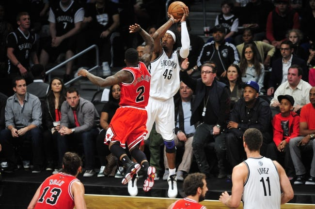 May 4, 2013; Brooklyn, NY, USA; Brooklyn Nets small forward Gerald Wallace (45) puts up a shot over Chicago Bulls point guard Nate Robinson (2) during the second half in game seven of the first round of the 2013 NBA Playoffs at the Barclays Center. The Bulls won 99-93. Mandatory Credit: Joe Camporeale-USA TODAY Sports