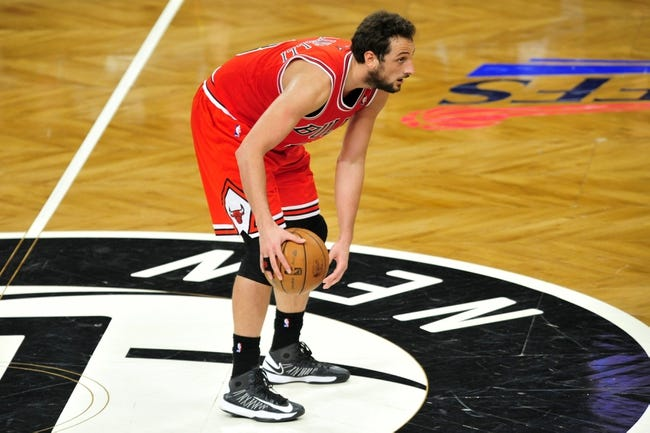 May 4, 2013; Brooklyn, NY, USA; Chicago Bulls shooting guard Marco Belinelli (8) dribbles against the Brooklyn Nets during the second half in game seven of the first round of the 2013 NBA Playoffs at the Barclays Center. The Bulls won 99-93. Mandatory Credit: Joe Camporeale-USA TODAY Sports