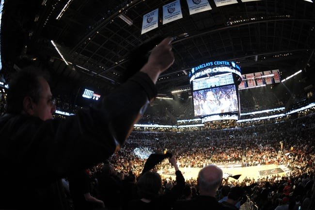 May 4, 2013; Brooklyn, NY, USA; A general view of Brooklyn Nets fans celebrating against the Chicago Bulls during the second half in game seven of the first round of the 2013 NBA Playoffs at the Barclays Center. The Bulls won 99-93. Mandatory Credit: Joe Camporeale-USA TODAY Sports