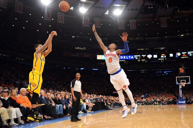 May 5, 2013; New York, NY, USA; Indiana Pacers point guard George Hill (3) puts up a three point shot over New York Knicks shooting guard J.R. Smith (8) during the second half of game one of the second round of the NBA Playoffs. Pacers won the game 102-95. Mandatory Credit: Joe Camporeale-USA TODAY Sports
