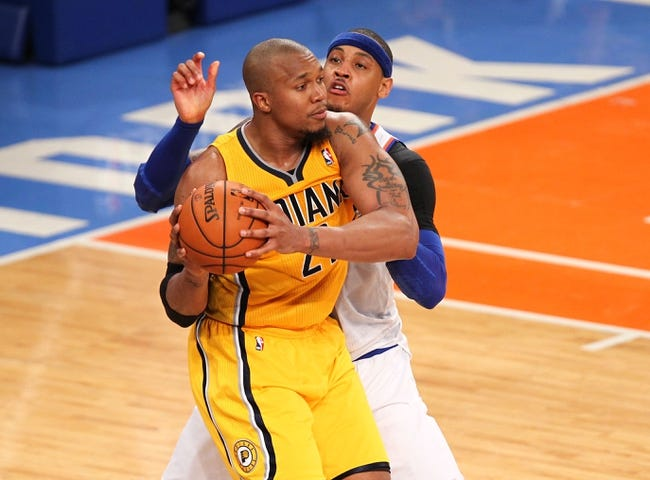 May 5, 2013; New York, NY, USA; New York Knicks forward Carmelo Anthony (7) defends Indiana Pacers forward David West (21) during the second half of game one of the second round of the NBA Playoffs at Madison Square Garden. Mandatory Credit: Danny Wild-USA TODAY Sports
