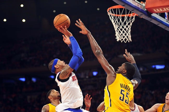 May 5, 2013; New York, NY, USA; New York Knicks small forward Carmelo Anthony (7) puts up a shot over Indiana Pacers center Roy Hibbert (55) during the first half of game one of the second round of the NBA Playoffs. Pacers won the game 102-95. Mandatory Credit: Joe Camporeale-USA TODAY Sports