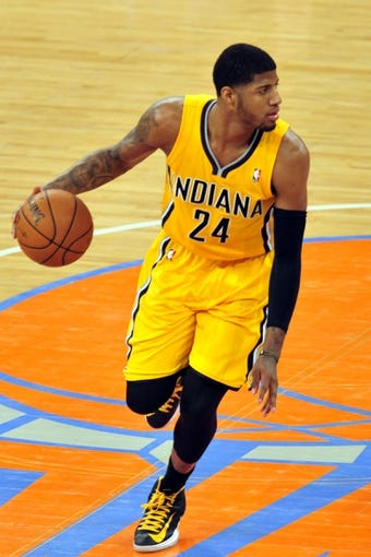 May 7, 2013; New York, NY, USA; Indiana Pacers small forward Paul George (24) dribbles against the New York Knicks during the first half in game two of the second round of the 2013 NBA Playoffs at Madison Square Garden. Knicks won the game 105-79. Mandatory Credit: Joe Camporeale-USA TODAY Sports