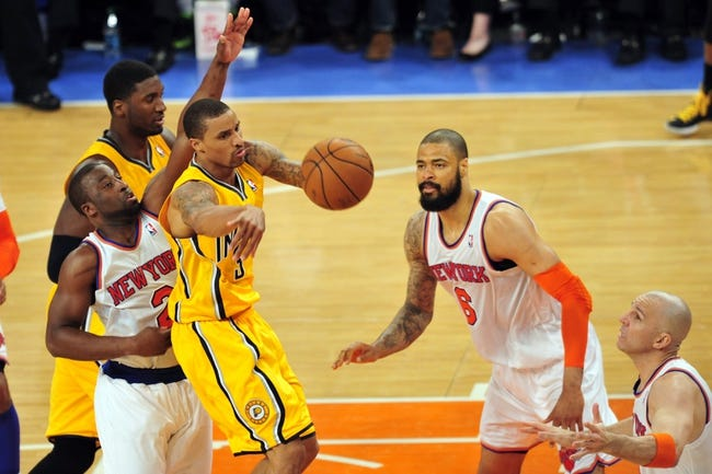 May 7, 2013; New York, NY, USA; Indiana Pacers point guard George Hill (3) makes a pass against New York Knicks defenders during the first half in game two of the second round of the 2013 NBA Playoffs at Madison Square Garden. Mandatory Credit: Joe Camporeale-USA TODAY Sports