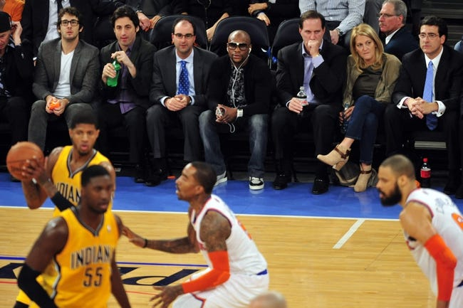 May 7, 2013; New York, NY, USA; Boxing champion Floyd Mayweather (top center) looks on during the first half in game two of the second round of the 2013 NBA Playoffs between the New York Knicks and Indiana Pacers at Madison Square Garden. Knicks won the game 105-79. Mandatory Credit: Joe Camporeale-USA TODAY Sports