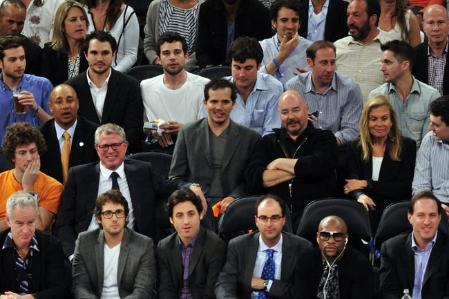 May 7, 2013; New York, NY, USA; Film actor John Leguizamo (center) looks on during the first half in game two of the second round of the 2013 NBA Playoffs between the New York Knicks and Indiana Pacers at Madison Square Garden. Knicks won the game 105-79. Mandatory Credit: Joe Camporeale-USA TODAY Sports