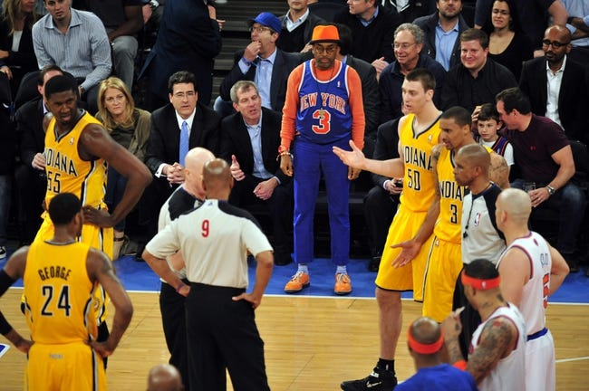 May 7, 2013; New York, NY, USA; Actor and director Spike Lee (center) looks on during the first half in game two of the second round of the 2013 NBA Playoffs between the Indiana Pacers and New York Knicks at Madison Square Garden. Knicks won the game 105-79. Mandatory Credit: Joe Camporeale-USA TODAY Sports