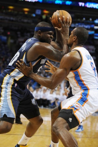 May 7, 2013; Oklahoma City, OK, USA; Memphis Grizzlies forward Zach Randolph (50) handles the ball against Oklahoma City Thunder forward Serge Ibaka (9) during the first half in game two of the second round of the 2013 NBA Playoffs at Chesapeake Energy Arena. Mandatory Credit: Mark D. Smith-USA TODAY Sports