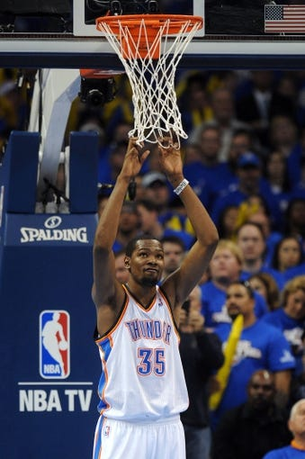 May 7, 2013; Oklahoma City, OK, USA; Oklahoma City Thunder forward Kevin Durant (35) reacts to play against the Memphis Grizzlies during the second half in game two of the second round of the 2013 NBA Playoffs at Chesapeake Energy Arena. Mandatory Credit: Mark D. Smith-USA TODAY Sports