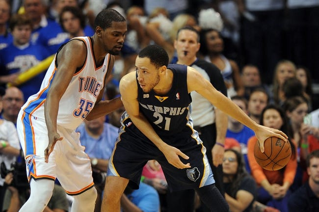 May 7, 2013; Oklahoma City, OK, USA; Memphis Grizzlies Tayshaun Prince (21) handles the ball against Oklahoma City Thunder forward Kevin Durant (35) during the second half in game two of the second round of the 2013 NBA Playoffs at Chesapeake Energy Arena. Mandatory Credit: Mark D. Smith-USA TODAY Sports