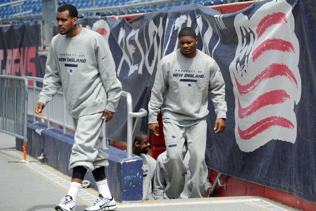 May 3, 2013; Foxboro, MA USA; New England Patriots rookies Aaron Dobson of Marshall and Jamie Collins of Southern Mississippi walk onto the field to meet with the media during rookie minicamp at Gillette Stadium. Mandatory Credit: Bob DeChiara-USA TODAY Sports