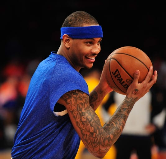May 5, 2013; New York, NY, USA; New York Knicks small forward Carmelo Anthony (7) warms up before the first half of game one of the second round of the NBA Playoffs against the Indiana Pacers. Pacers won the game 102-95. Mandatory Credit: Joe Camporeale-USA TODAY Sports
