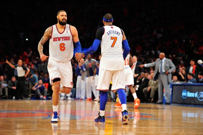 May 5, 2013; New York, NY, USA; New York Knicks center Tyson Chandler (6) and small forward Carmelo Anthony (7) slap hands after a Chandler dunk against the Indiana Pacers during the second half of game one of the second round of the NBA Playoffs. Pacers won the game 102-95. Mandatory Credit: Joe Camporeale-USA TODAY Sports