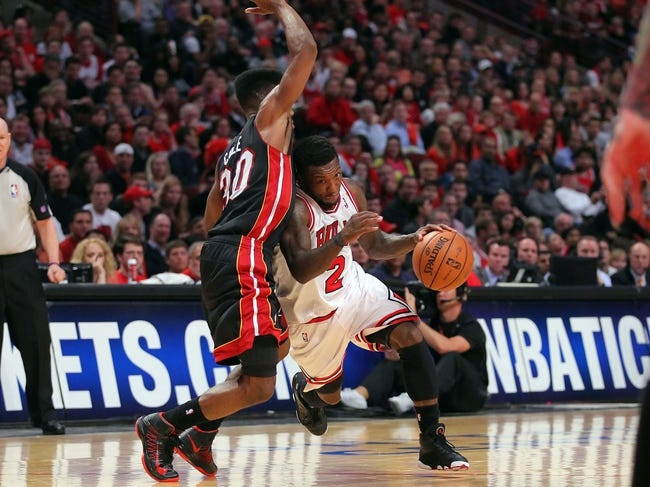 May 10, 2013; Chicago, IL, USA; Chicago Bulls point guard Nate Robinson (2) drives against Miami Heat point guard Norris Cole (30) during the second half in game three of the second round of the 2013 NBA Playoffs at the United Center. Miami won 104-94. Mandatory Credit: Dennis Wierzbicki-USA TODAY Sports