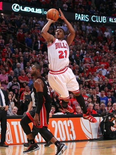 May 10, 2013; Chicago, IL, USA; Chicago Bulls small forward Jimmy Butler (21) shoots over Miami Heat shooting guard Dwyane Wade (3) during the second half in game three of the second round of the 2013 NBA Playoffs at the United Center. Miami won 104-94. Mandatory Credit: Dennis Wierzbicki-USA TODAY Sports