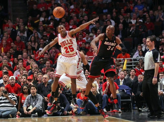 May 10, 2013; Chicago, IL, USA; Chicago Bulls point guard Marquis Teague (25) attempts to block a pass from Miami Heat shooting guard Ray Allen (34) during the second half in game three of the second round of the 2013 NBA Playoffs at the United Center. Miami won 104-94. Mandatory Credit: Dennis Wierzbicki-USA TODAY Sports