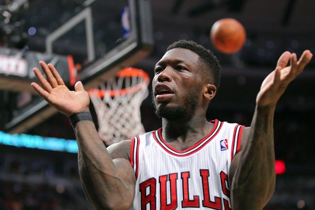 May 10, 2013; Chicago, IL, USA; Chicago Bulls point guard Nate Robinson (2) claps to excite the crowd during the second half in game three of the second round of the 2013 NBA Playoffs against the Miami Heat at the United Center. Miami won 104-94. Mandatory Credit: Dennis Wierzbicki-USA TODAY Sports